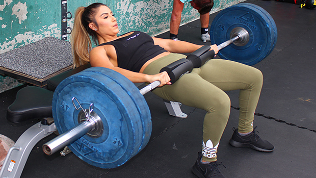 woman building glutes using hip thrust exercise