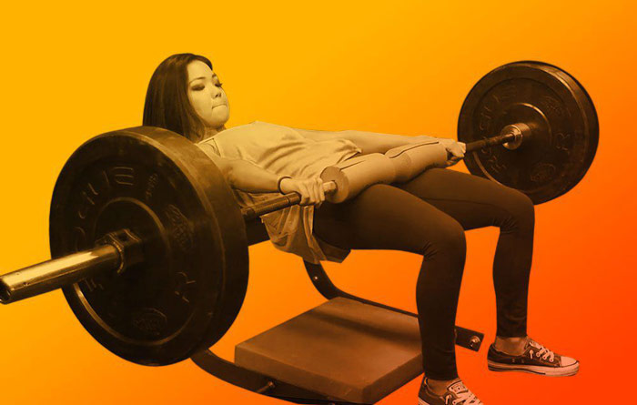 female athlete at top of hip thrust exercise