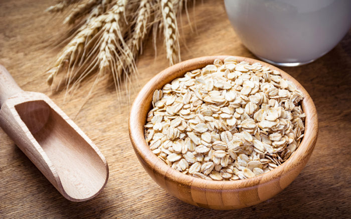 a bowl of oats on a wooden table