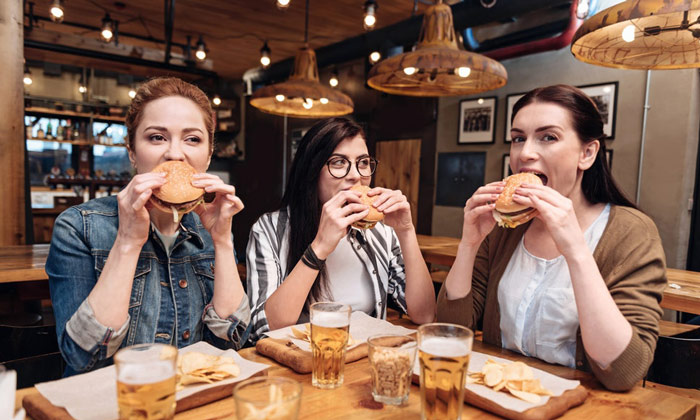 group of women enjoying a meal as part of IIFYM flexible diet