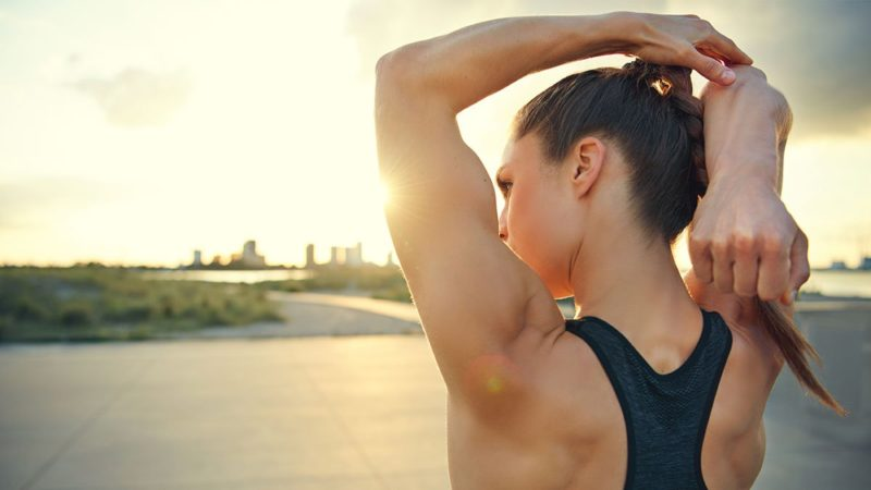 Woman with defined arms after a triceps workout for women