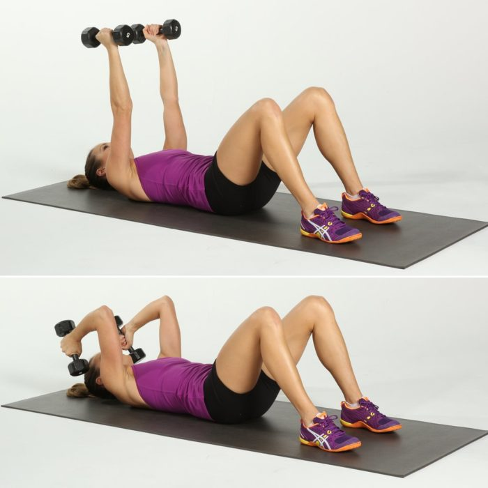 woman performing a skull crusher as part of her triceps workout for women