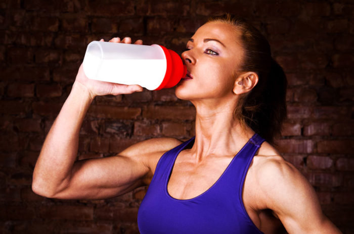 Woman drinking pre-workout