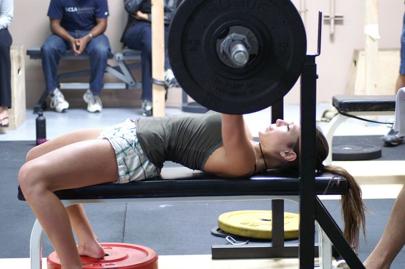 Woman performing bench press