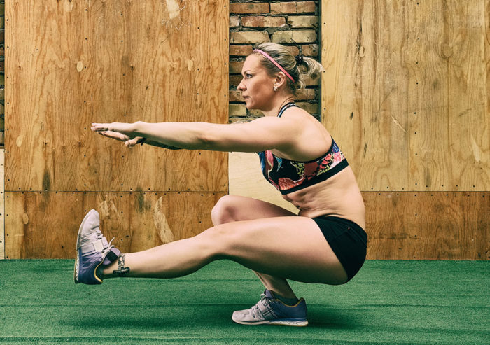 woman performing a single leg squat