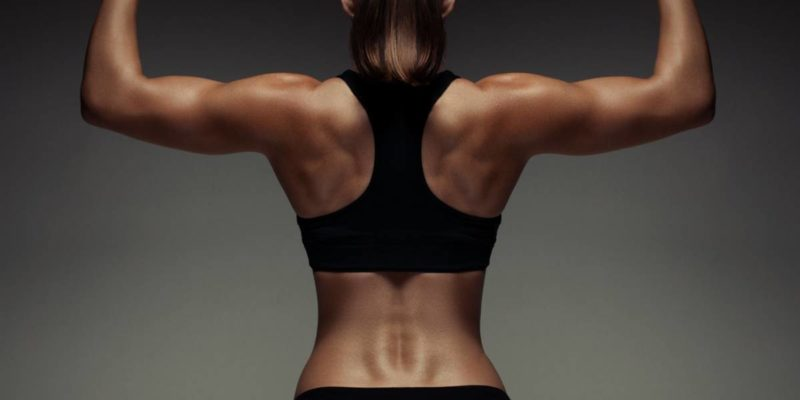 best shoulder workout for strength feature image of woman with defined shoulders