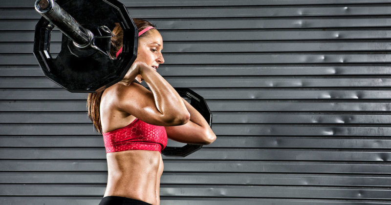 woman in a sports bra in a weightlifting workout