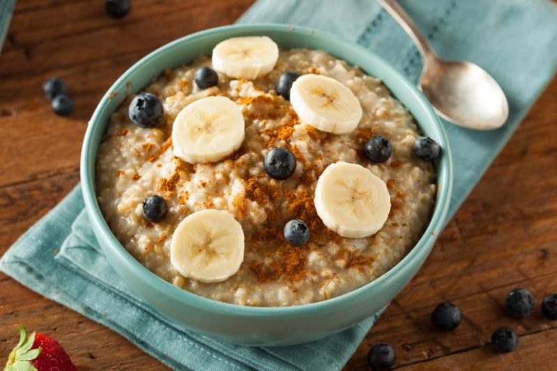 Bowl of oatmeal with cinnamon and banana on top