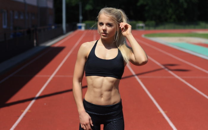 Woman with a strong core on a running track