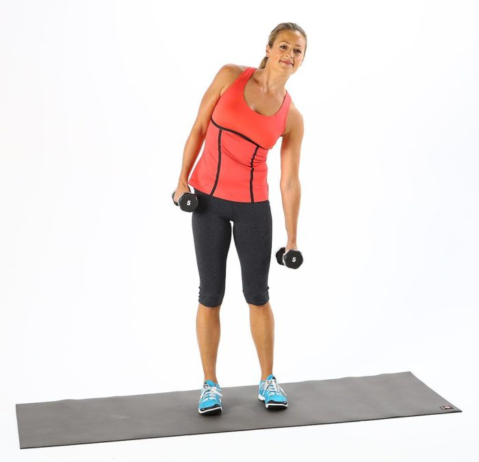 woman doing a dumbbell side bend