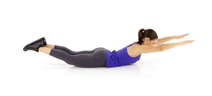 woman performing a super man exercise