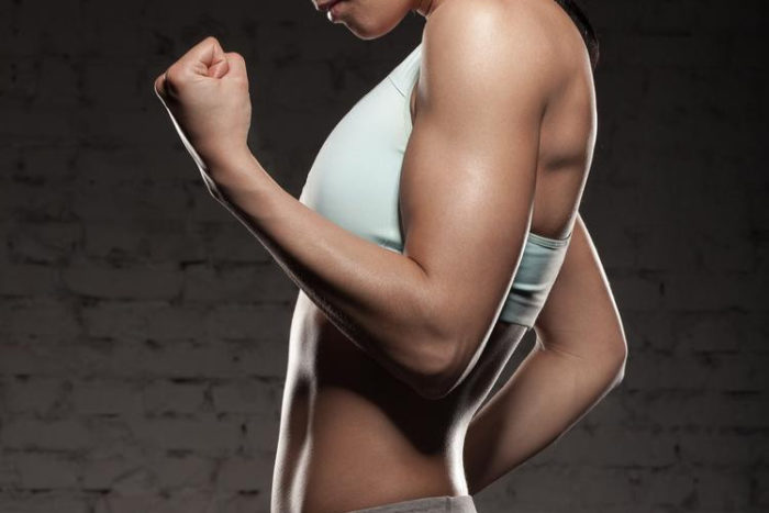 woman with strong arms and muscle hypertrophy