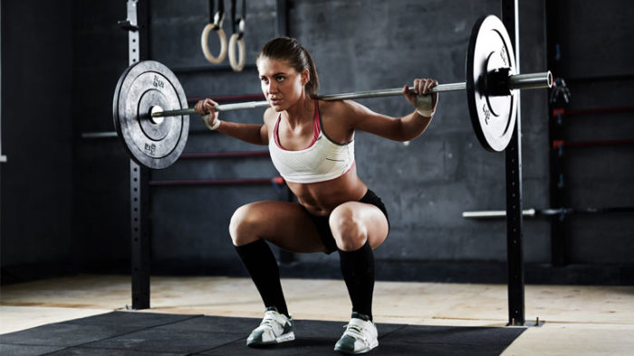 Healthy woman performing a back squat as a healthy alternative
