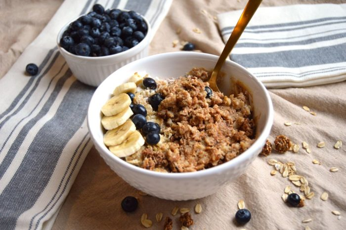 Bowl of porridge oats with banana and buleberry on top