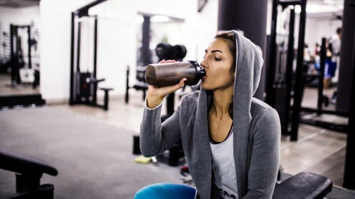 woman drinking creatine shake