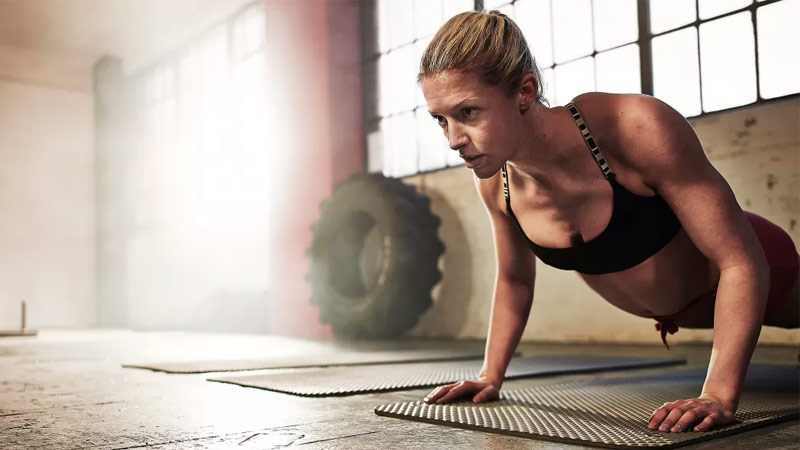 Woman performing push up as part of Tabata workout