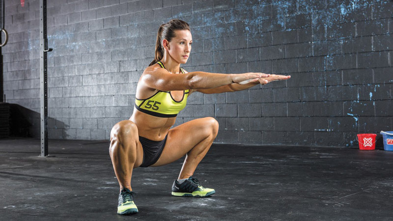 woman performing air squat as part of Tabata workout