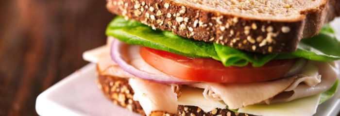 a close up of a healthy turkey sandwich as a lunch meal