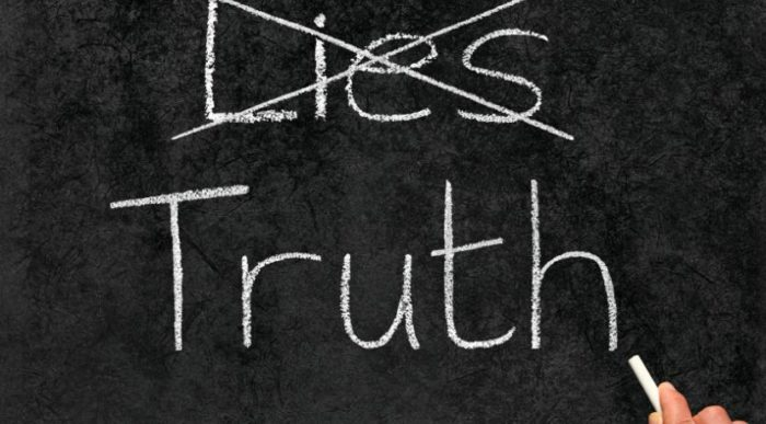 a chalk board with lies crossed out and the word truth written below