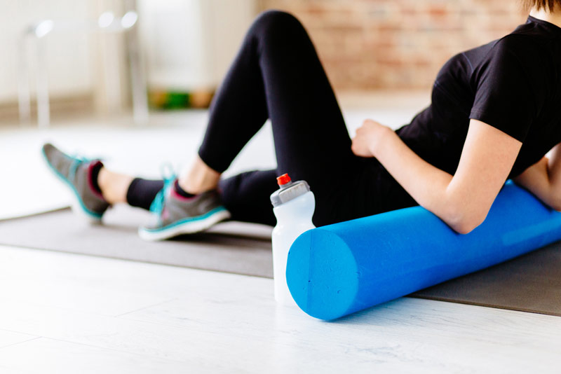 woman using soft foam roller