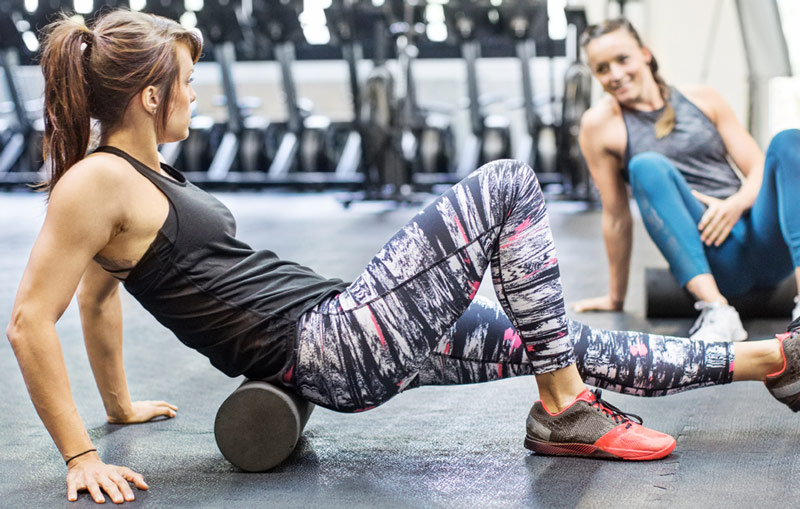 woman using foam roller for lower back