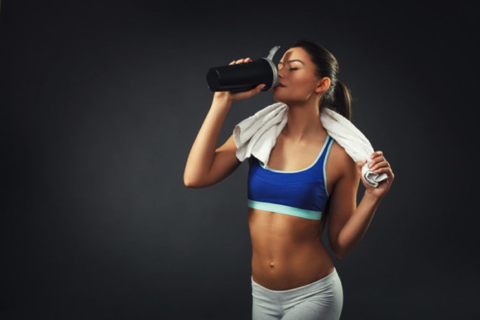 Woman taking a fat burner