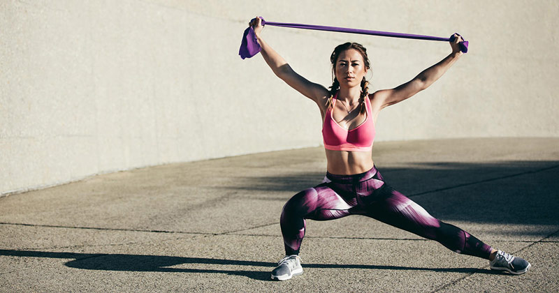 woman performing resistance band workout