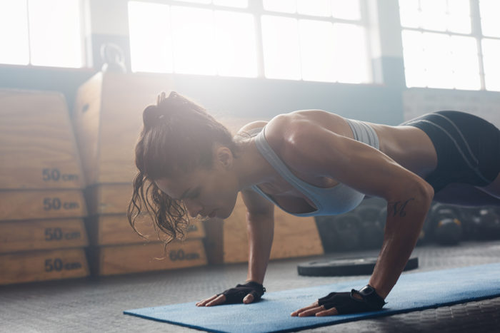 Woman peforming a burpee as part of a HIIT cardio workout