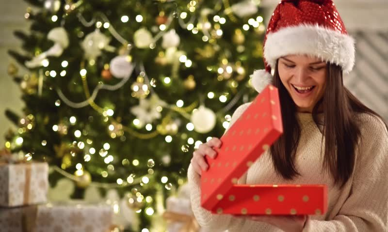 woman opening a christmas gift