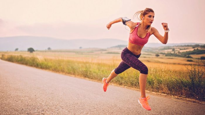 woman sprinting as part of a HIIT workout