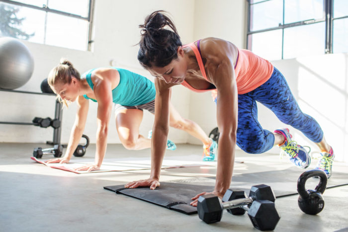 woman working out using the best workout programs for women