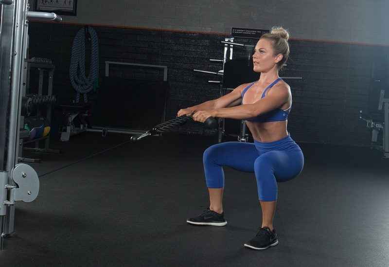 nikki zager performing a Shape and burn workout