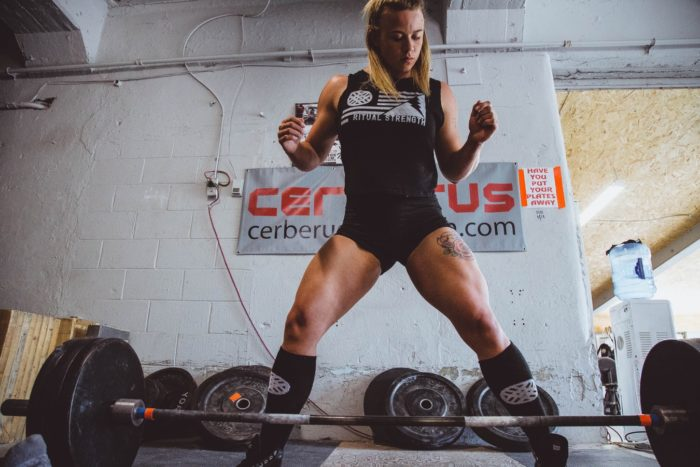 woman about to start deadlifting