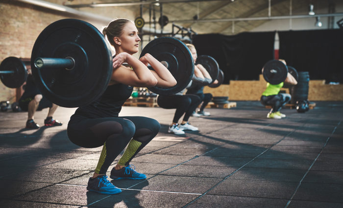 woman doing thrusters as hiit exercises