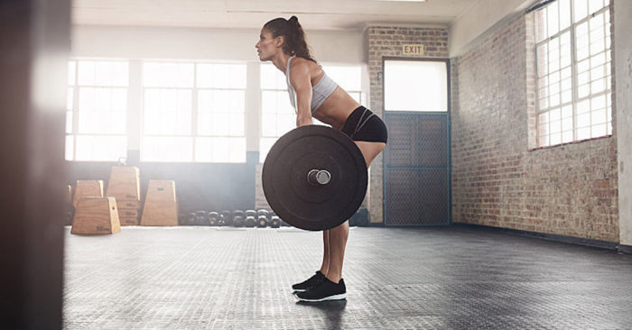 woman doing a stiff leg deadlift