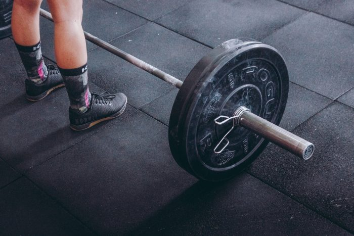 benefits of powerlifting for women as strength
