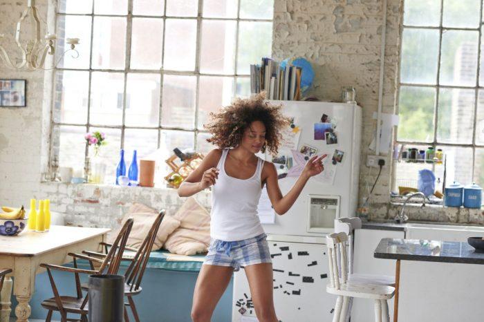 woman dancing at home